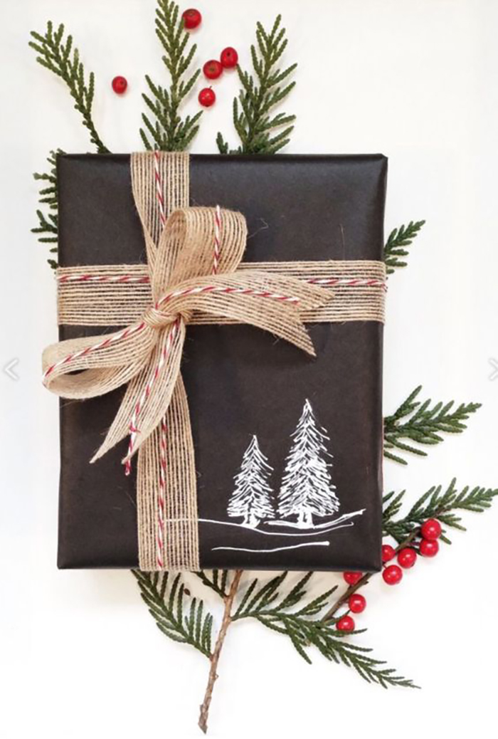 Take a dark colored wrapping paper, draw something on it with a white pen, add some ribbon and the gift is wrapped.