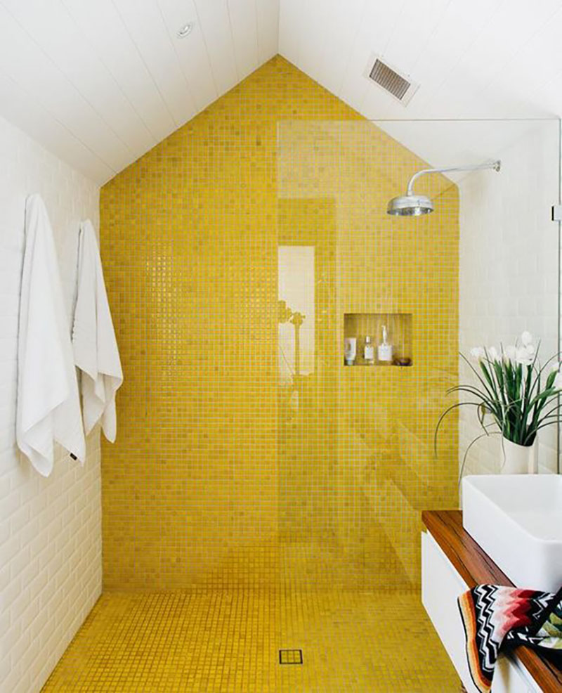 Yellow mosaic tiles combining with white look very energetic, it looks as the bath would be full with sunshine :-).