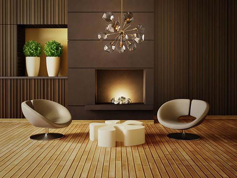 A fa padló természetességet sugall, nem nyomasztó a sötét barna fal sem vele kombinálva, mivel nagy a kontraszt és a bútorok világosak. Ez viszont csak világos helyiségben érvényesül jól.
