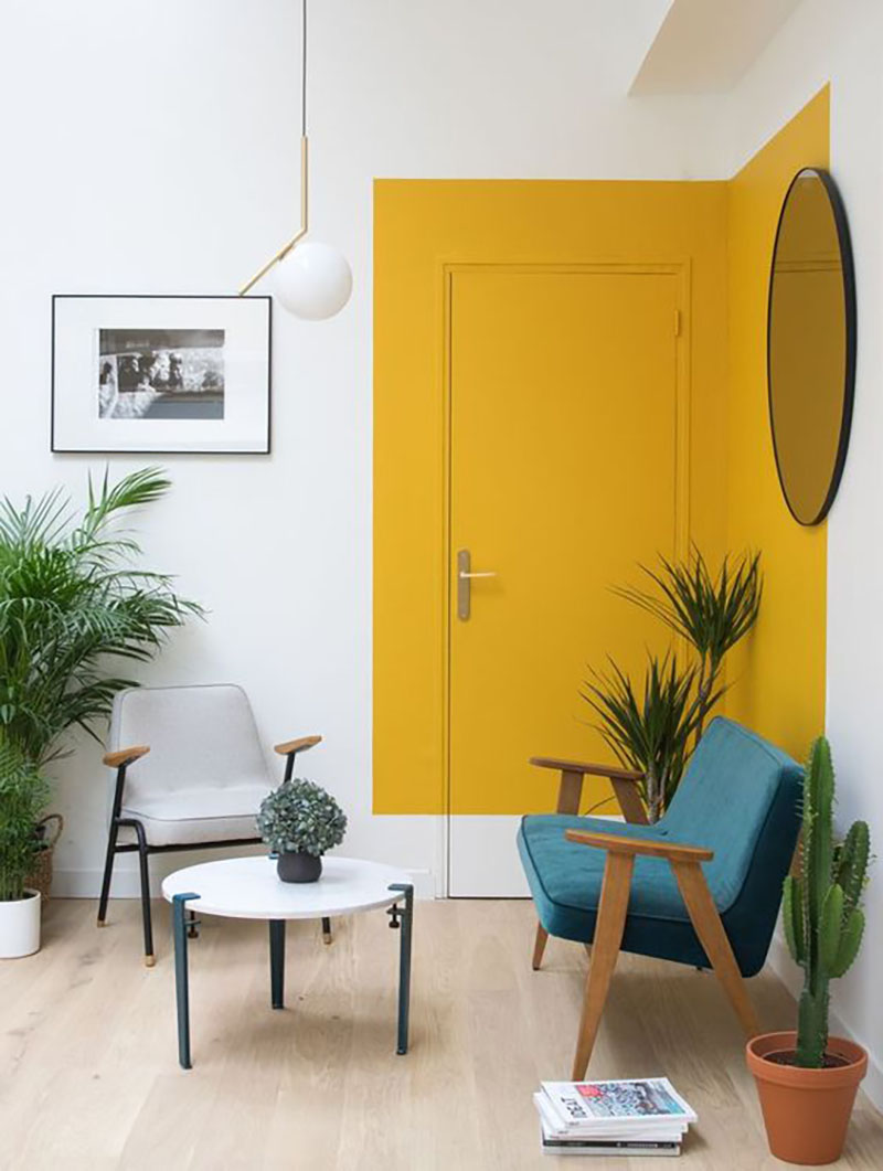 The white stripe at the bottom makes this yellow door special and also that the strip extends beyond the door, making it very unique.