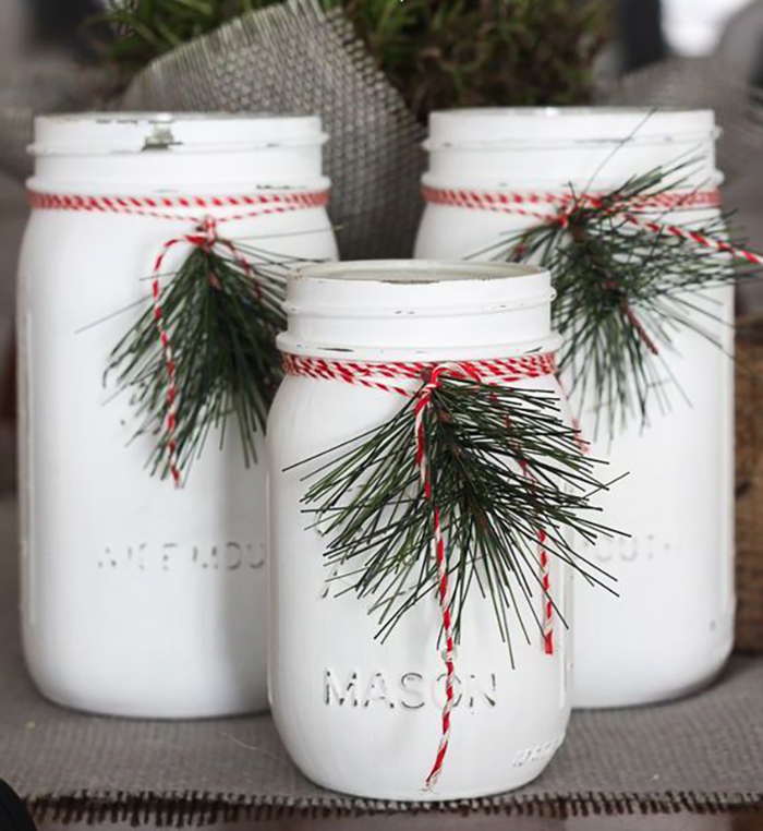 White painted jars in the colors of Christmas, in red and green.