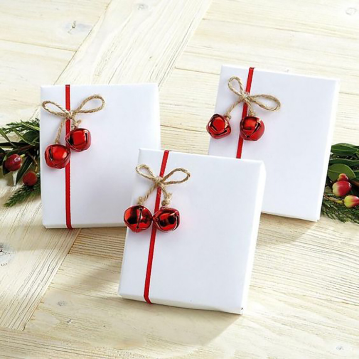 This is a simple one with plain white wrapping paper, the small red baubles remind me of cherries.