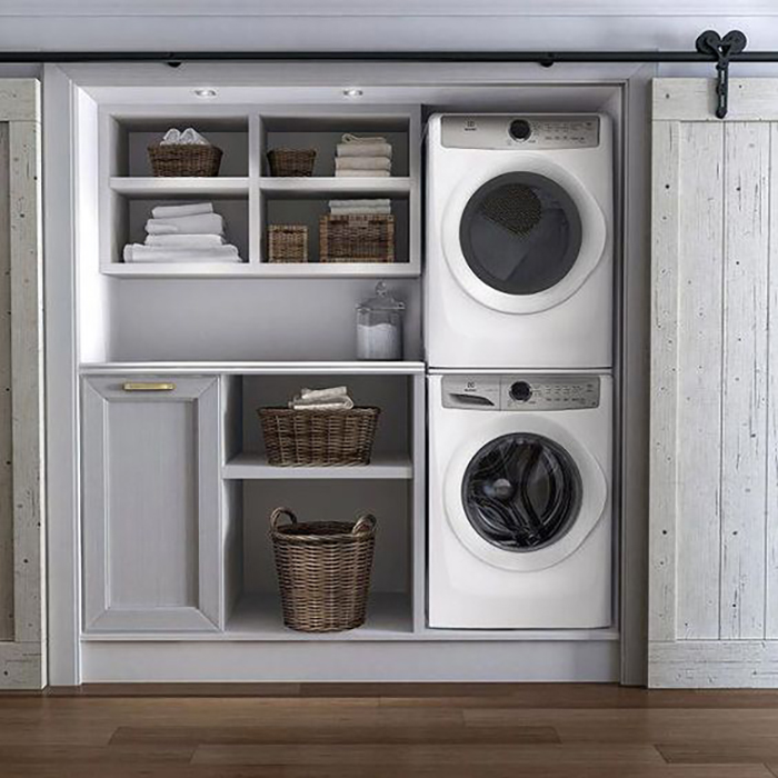 This is with a sliding door, this was planned mostly to hide the washing machine and the dryer.