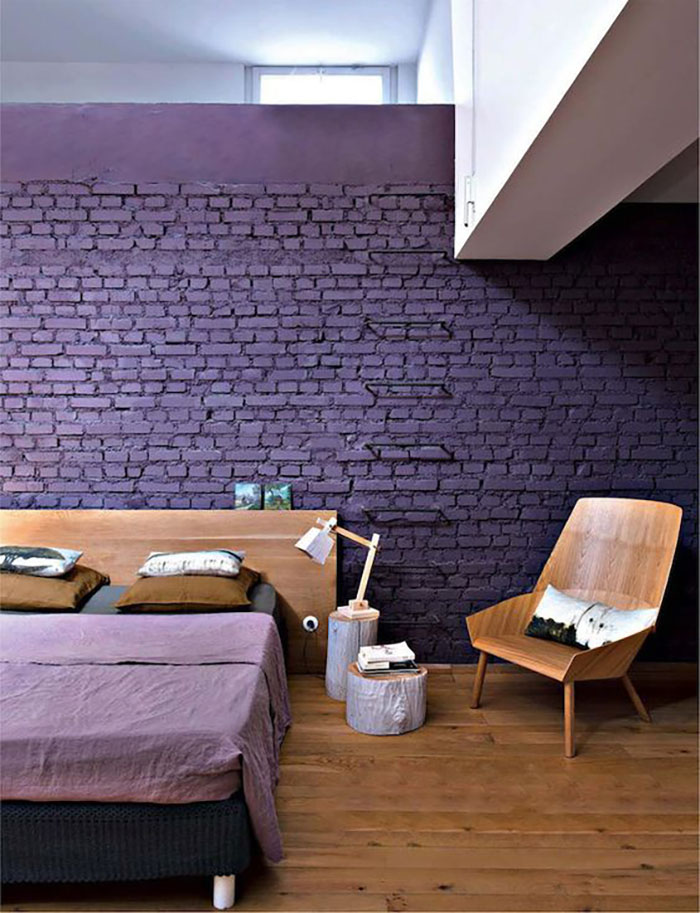 Brick walls are often left in the original color or they are painted white, but colored to purple is not often seen but is really cool.