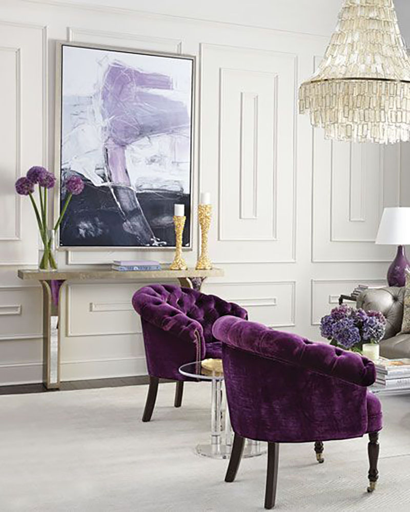 White, beige and gold combined with purple velvet armchairs make this room very elegant.