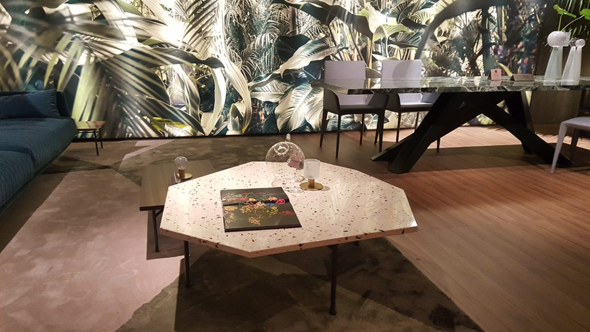 Jungle theme on the wall, terrazzo on the table at Bonaldo.