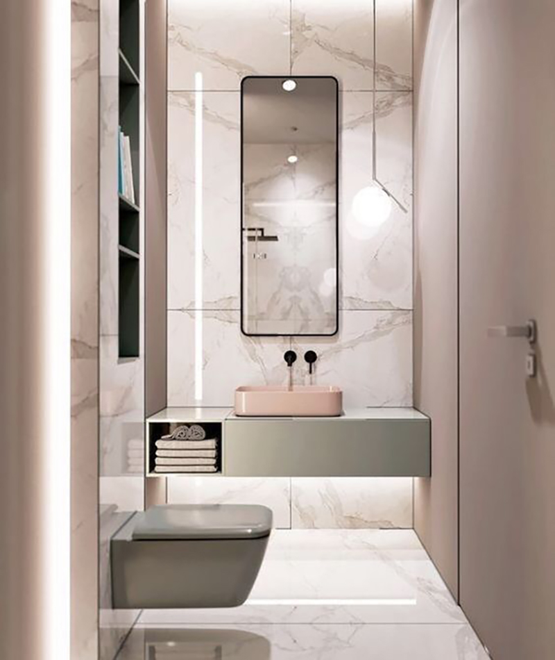 Green bathroom furniture with pale pink wash basin combined with marble. I love this design.