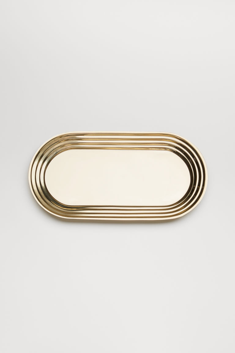 Gold oval metal tray from H&M Home.