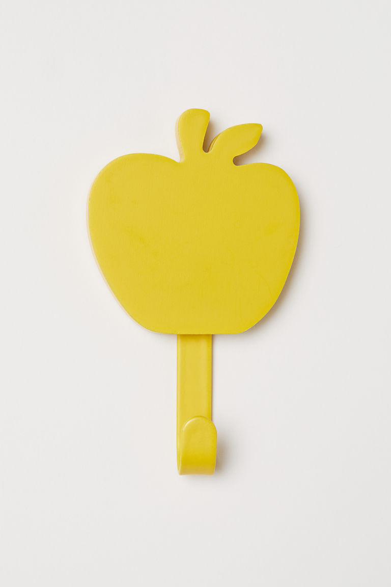 Sárga alma formájú akasztó (H&M Home).