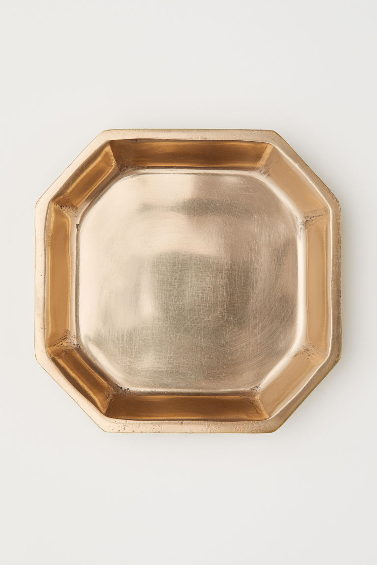 Gold colored tray from H&M Home.