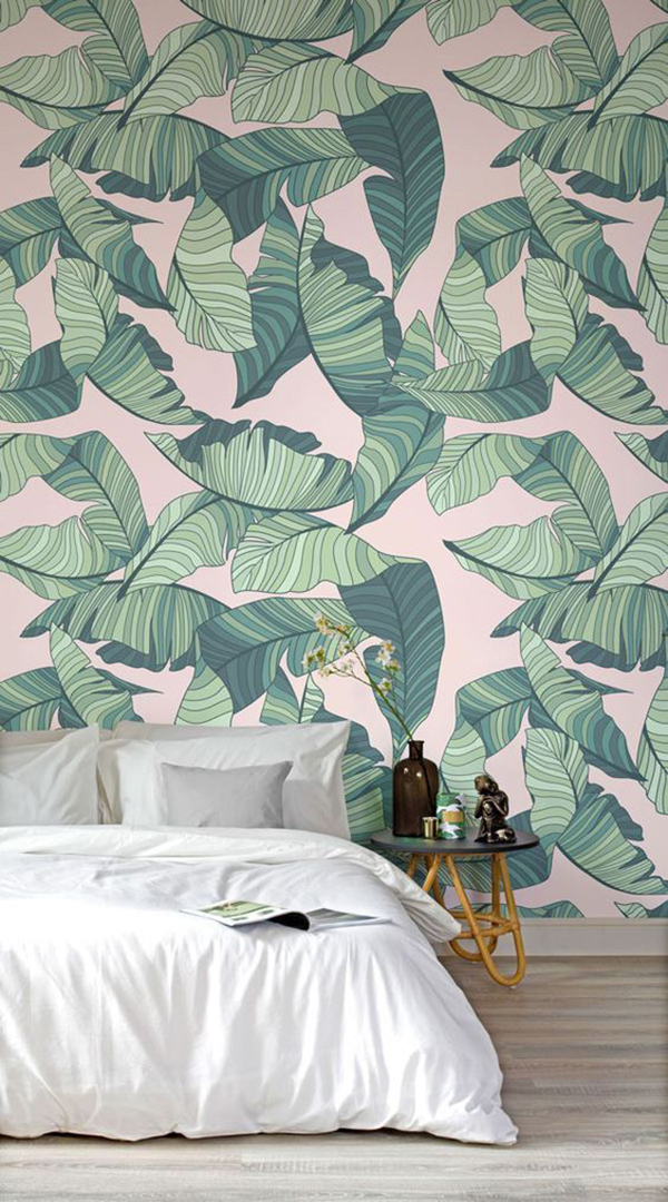 Big leaf-patterned wallpaper in pale pink and green. If you choose this option then add natural colored decoration otherwise it will be too much.